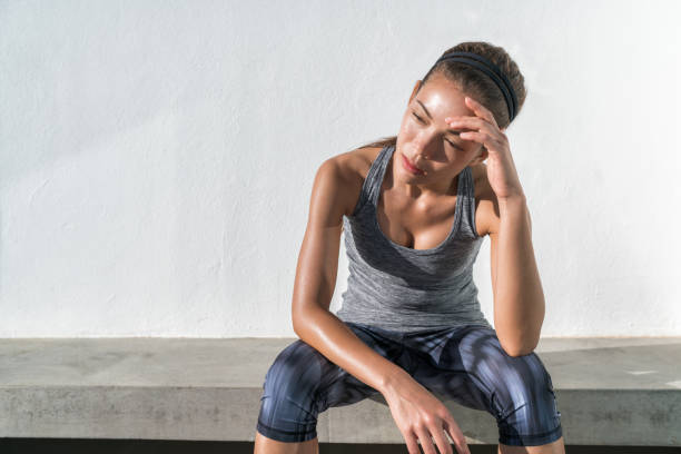Tired fitness running woman sweating exhausted stock photo