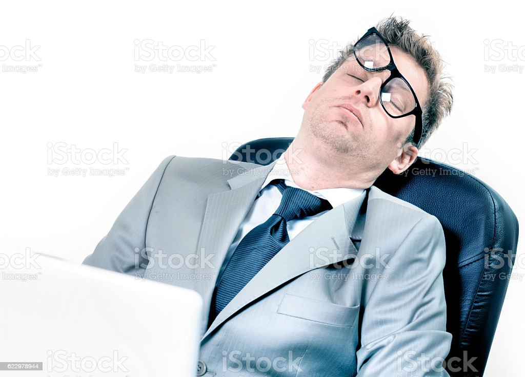 tired funny businessman at the office stock photo