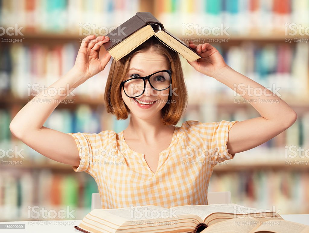 tired funny girl student with glasses reading books royalty-free stock photo