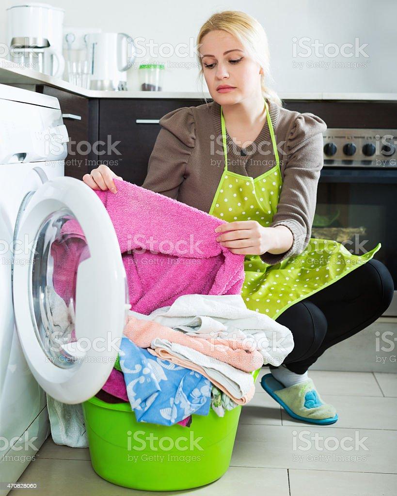 Tired girl doing laundry stock photo