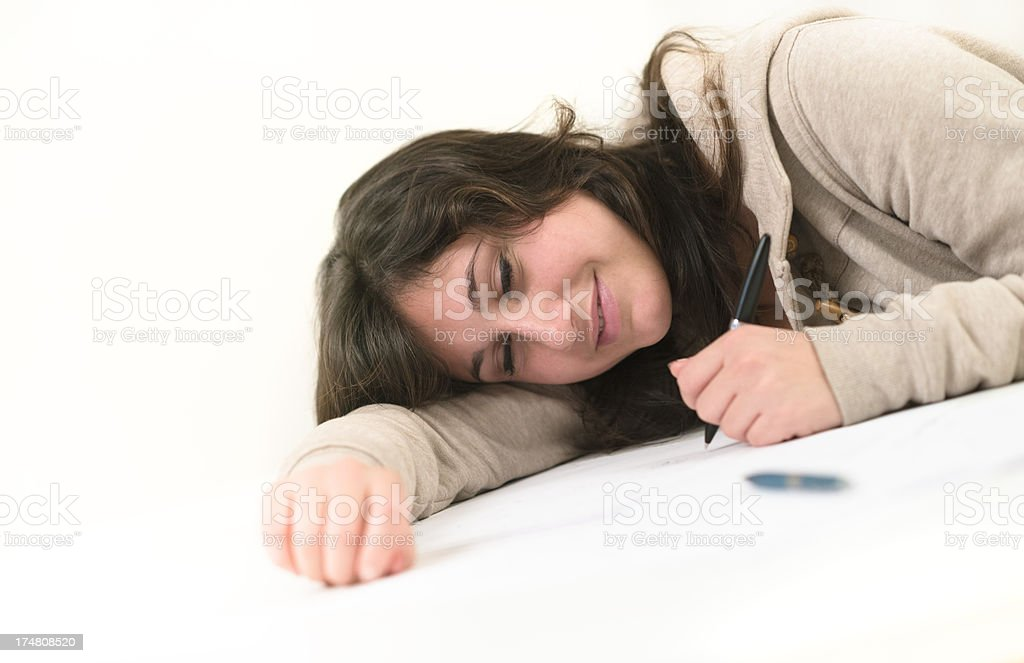 Tired girl studying on the table royalty-free stock photo