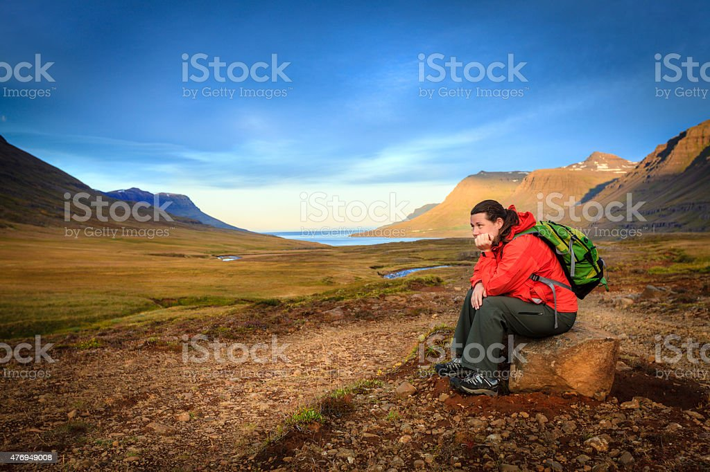 Tired hiker stock photo
