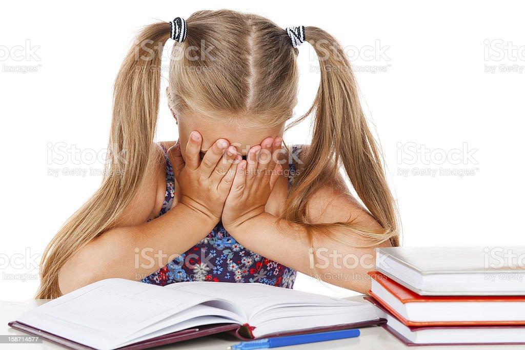Tired little girl does homework royalty-free stock photo