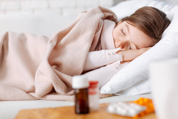 tired little girl having a nap - sleeping pill stock photos and pictures
