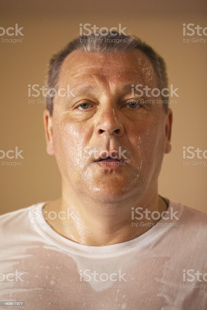 Tired looking middle-aged man after a workout stock photo