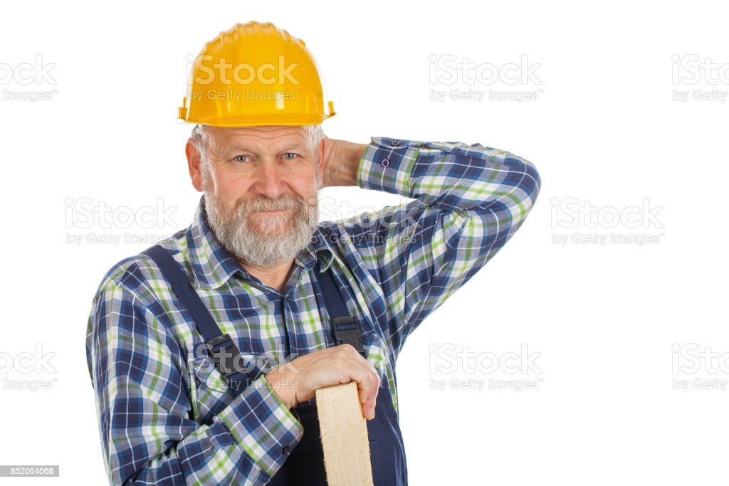 Tired male engineer holding a lath - isolated background stock photo