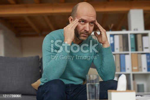 875602488 istock photo Tired man at office 1211739064