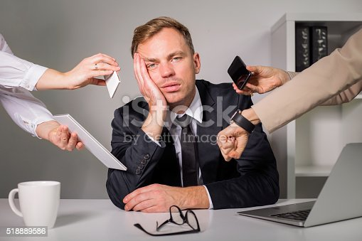 istock Tired man being overloaded at work 518889586