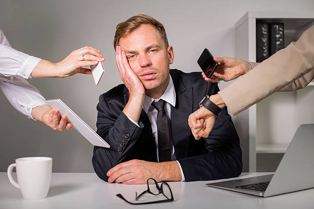 tired man being overloaded at work - busy stock photos and pictures