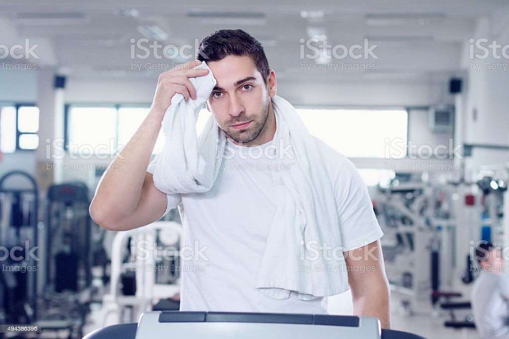 Tired Man Cleaning Sweat From Face stock photo