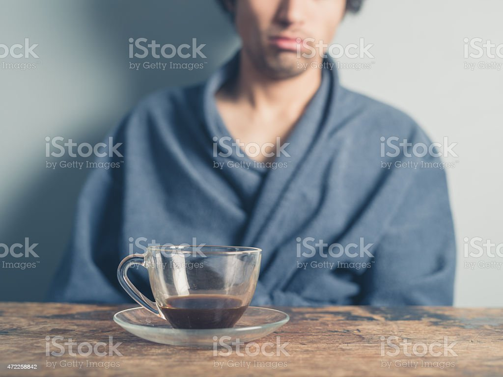 Tired man drinking coffee stock photo