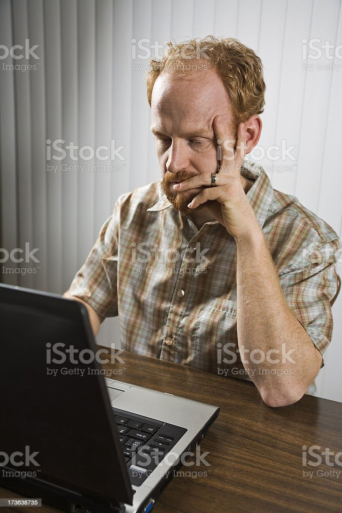 tired man falling asleep while working late on laptop computer royalty-free stock photo