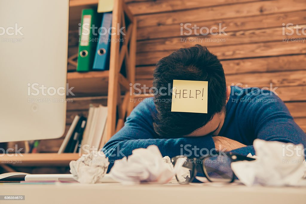 tired man having long working day and needing help stock photo