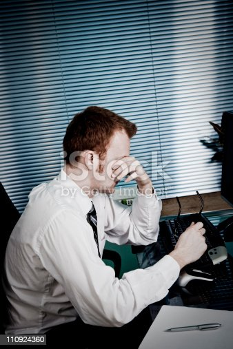 929420656 istock photo Tired man in office 110924360