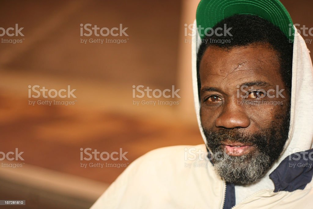 Tired Man in Sweatshirt and Green Hat stock photo