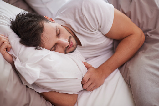 Tired Man Resting In The Bed Stock Photo - Download Image Now