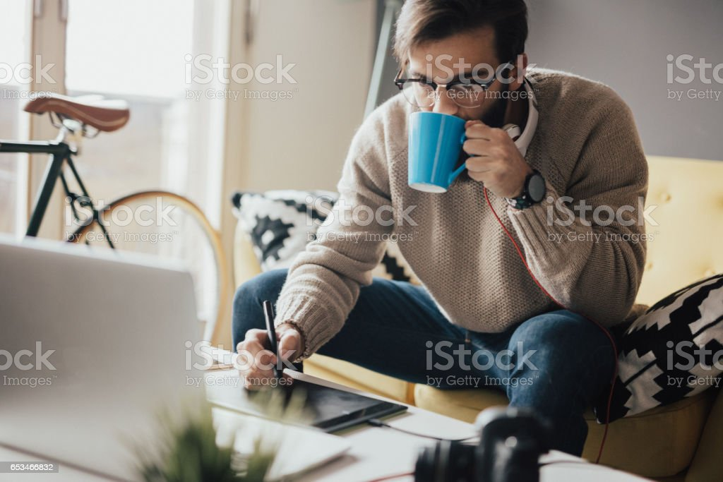 Tired man takes another coffee because he will work untill late hours stock photo