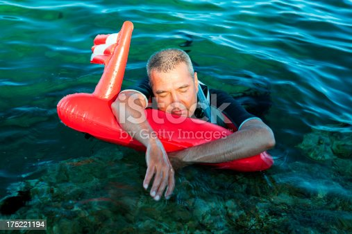 istock Tired man washed up on shore 175221194
