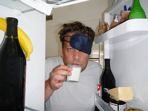 Tired man with sleep mask stock photo