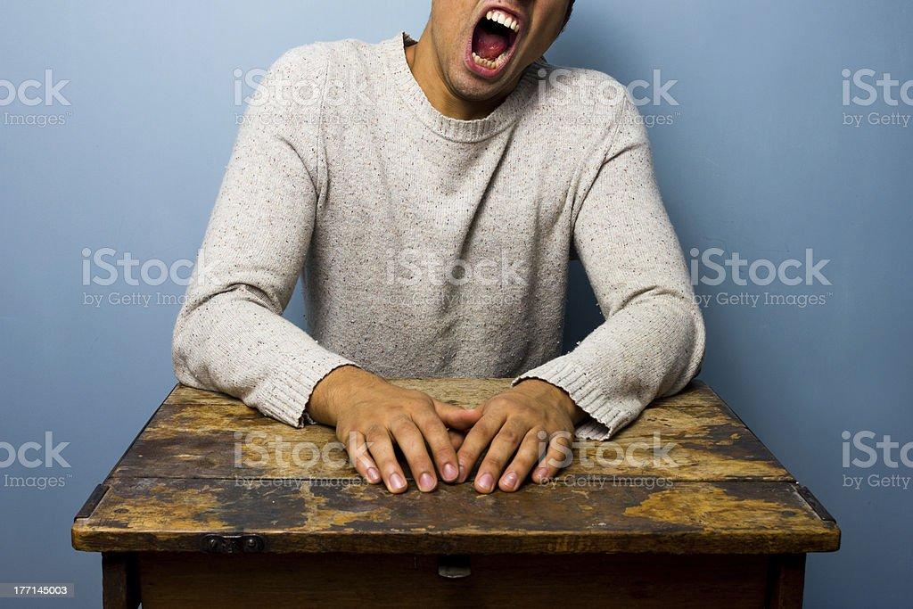 Tired man yawning royalty-free stock photo