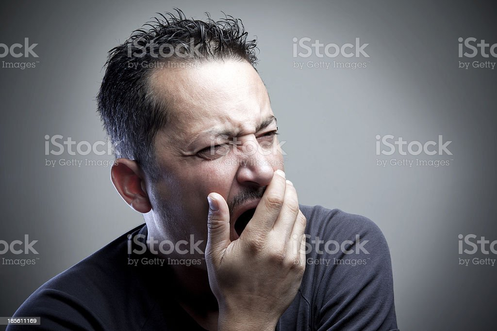 Tired Man Yawning stock photo
