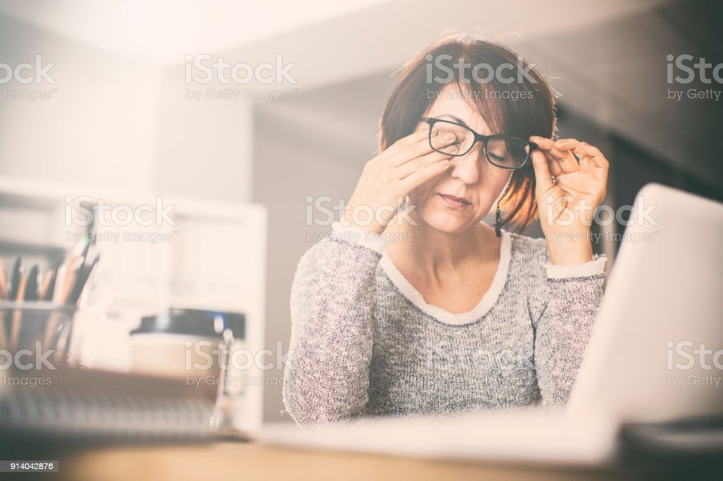 Tired middle age woman rubbing eyes - Royalty-free Adult Stock Photo