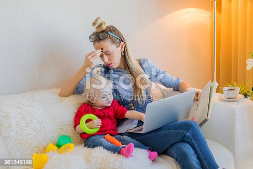 istock Tired mom trying to work on computer 961349196