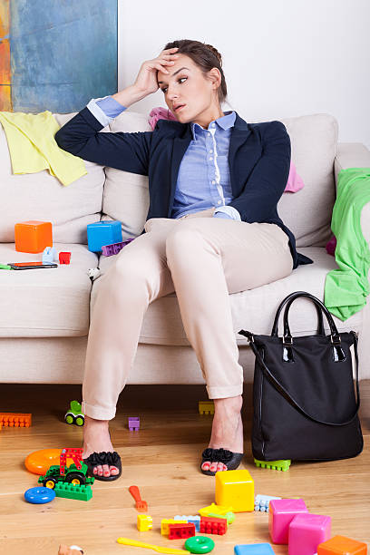 Tired mother after hard day at work stock photo