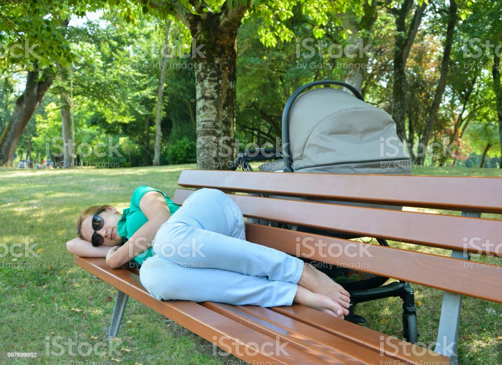 Tired Mother Asleep On A Bench In A Park Stock Photo More Pictures