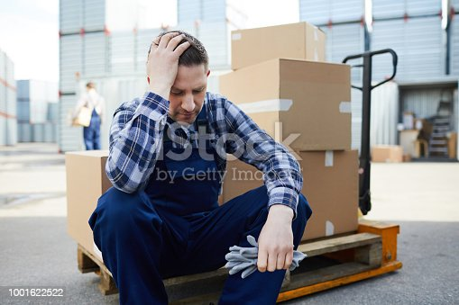 1001622522 istock photo Tired mover at cargo storage area 1001622522