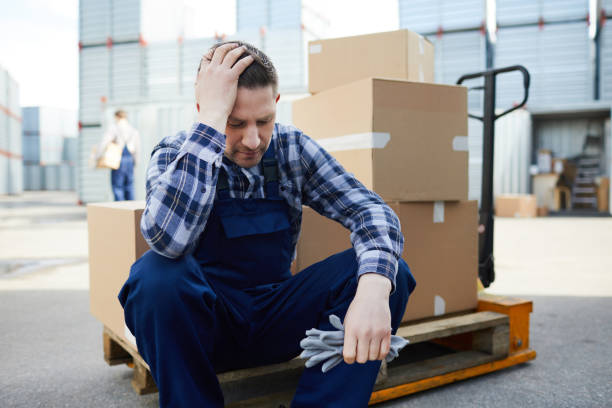 Tired mover at cargo storage area stock photo