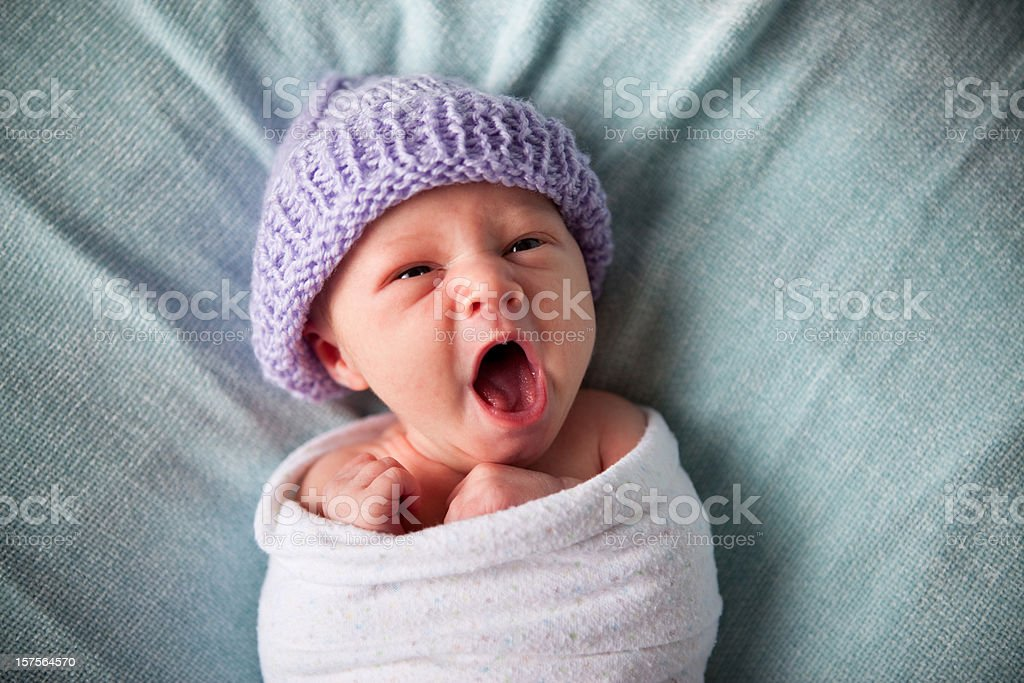 Tired Newborn Baby Yawning While Wrapped in Blanket - Royalty-free 0-1 Months Stock Photo