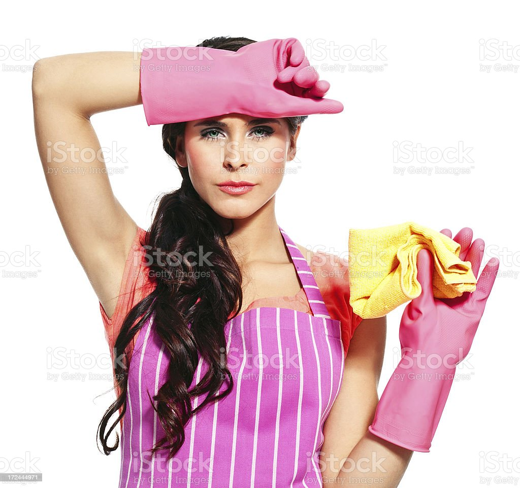 Tired of cleaning Portrait of an tired young woman wearing an apron and washing up gloves, holding a rag in hand. 20-24 Years Stock Photo