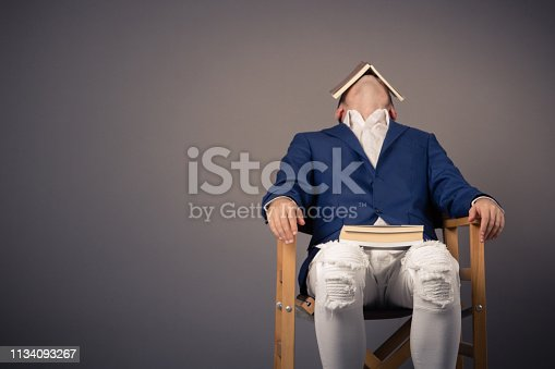 istock Tired of reading! 1134093267