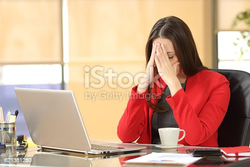 istock Tired overworked businesswoman at office 621381280