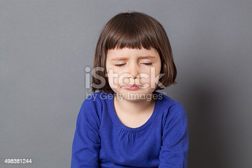 istock tired preschooler with eyes closed for boredom or exhaustion 498381244