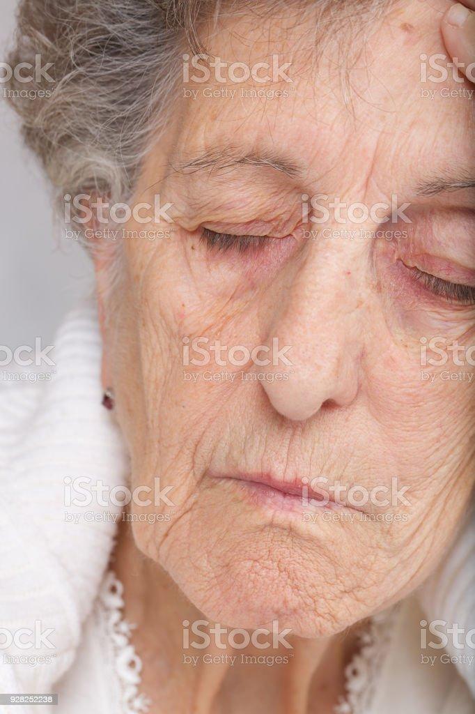 Tired senior woman. stock photo