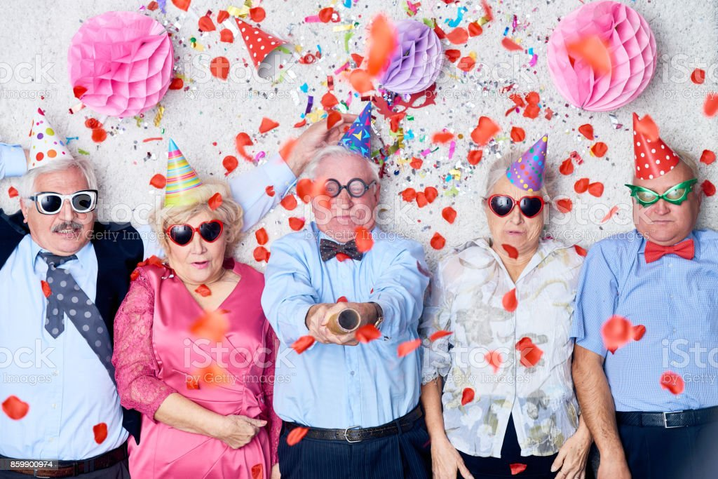 Tired seniors after Christmas party - fotografia de stock
