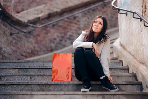 Tired Shopping Woman with Sore Feet Resting on Stairs
