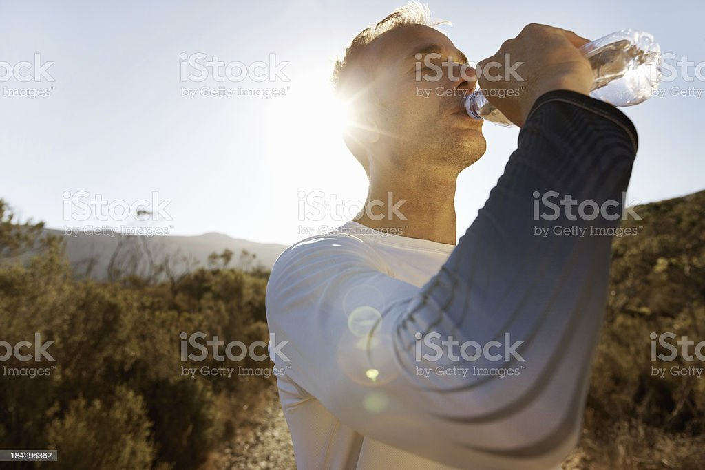 Tired sports man drinking water royalty-free stock photo
