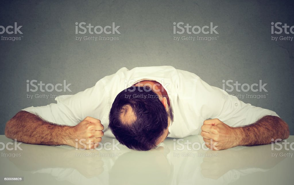 Tired, stressed man employee stock photo