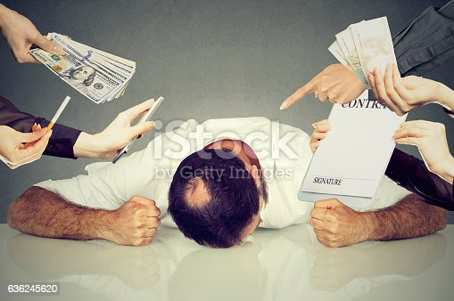 istock Tired stressed man overwhelmed by things to be done 636245620