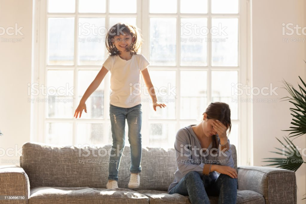 Tired stressed mom having headache feeling annoyed about noisy kid - fotografia de stock