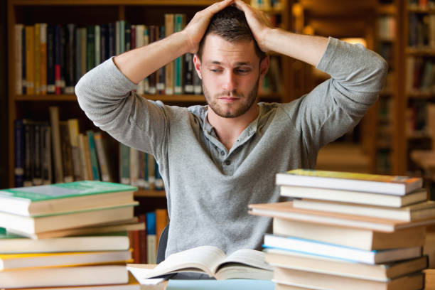 tired student having too much to do - frustrated man stock photos and pictures