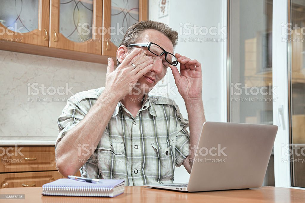 tired student rub his eyes stock photo