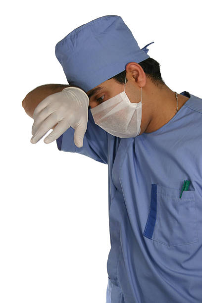 Tired Surgeon stock photo
