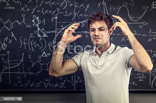 840623324istockphoto tired teacher portrait 1002031788