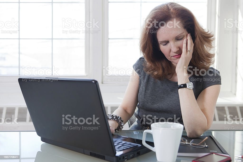 Tired woman at work royalty-free stock photo