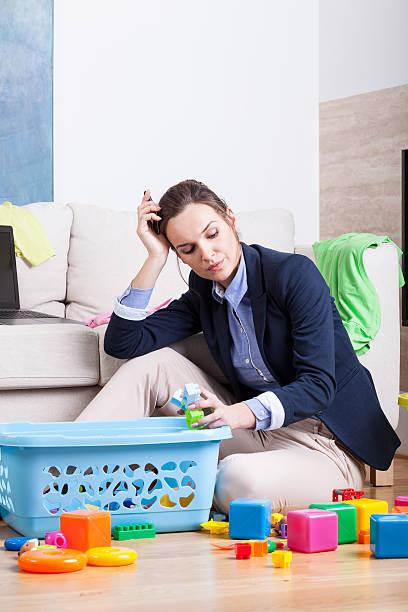 tired woman cleaning up room from toys - superwoman barn bildbanksfoton och bilder