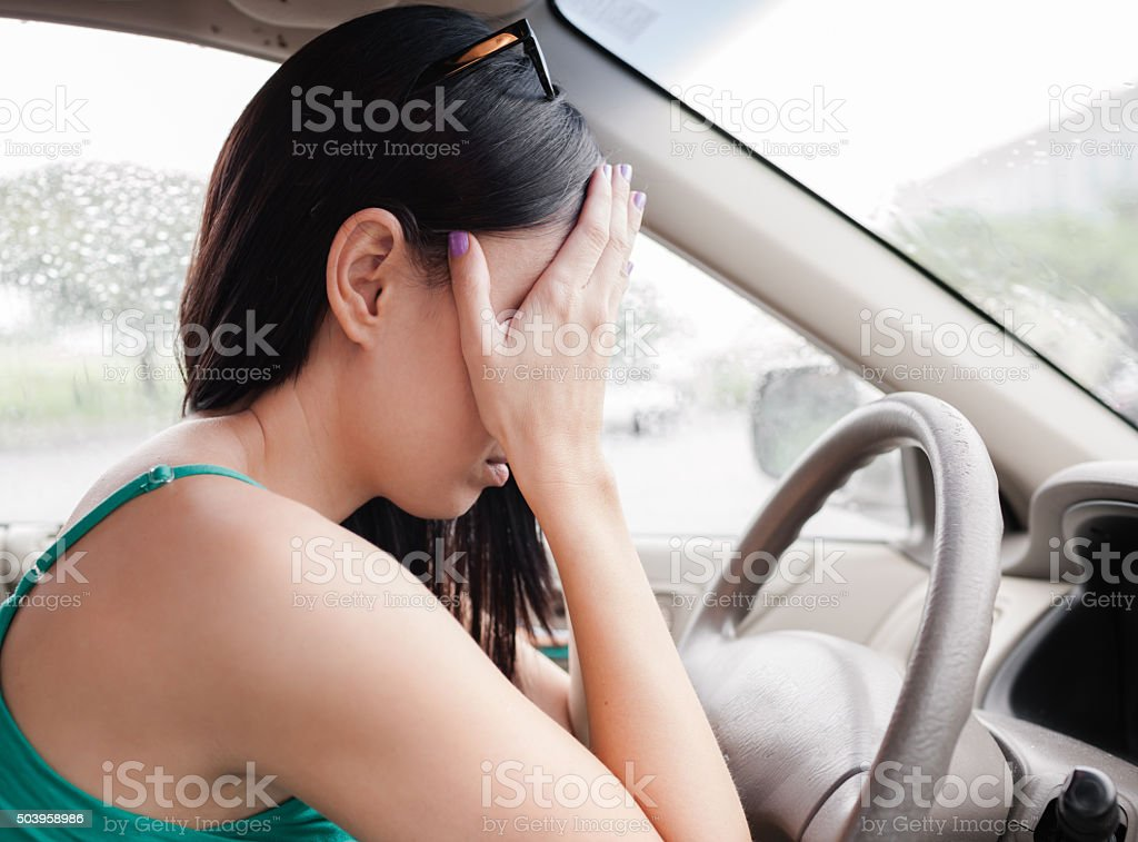 Tired woman driver stock photo